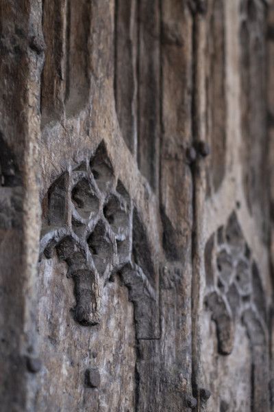 Picture of St Mary, Mildenhall, Suffolk: detail of carved woodwork on the north entrance door