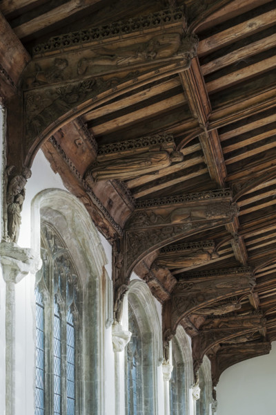 Picture of St Mary Mildenhall, Suffolk: detail of the carved brackets of the hammerbeam roof