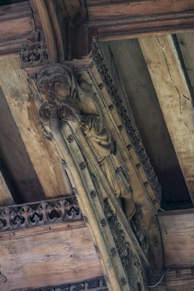 Picture of St Mary Mildenhall, Suffolk: detail of carved roof bracket with figure