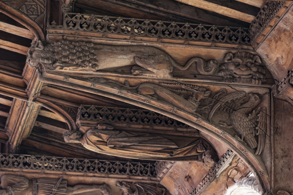 Picture of St Mary Mildenhall, Suffolk: detail of carved roof bracket with figures