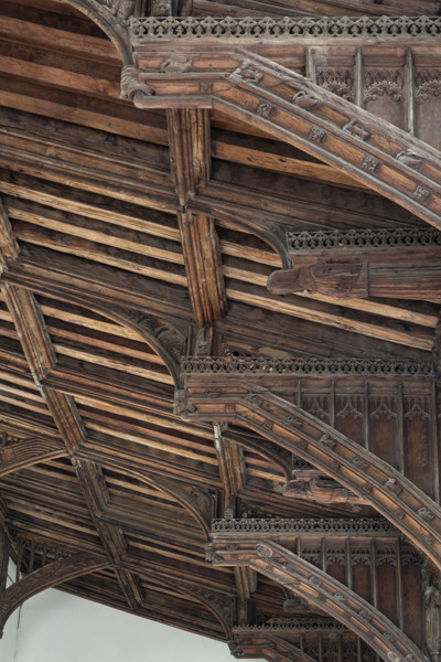Picture of St Mary Mildenhall, Suffolk: detail of carved roof brackets with figures