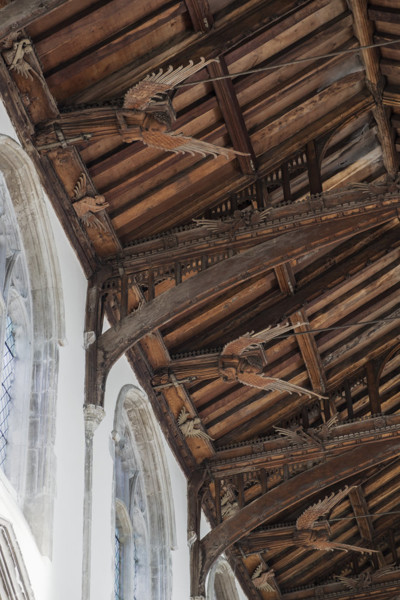 Picture of St Mary Mildenhall, Suffolk: detail of the carved brackets and angel figures on the hammerbeam roof