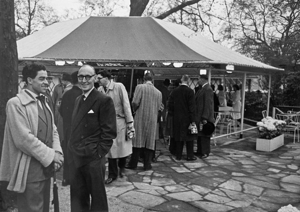 Picture of Leslie Gooday (left) in a coat knitted by his wife Rosemary, with a colleague at a function during the building of the Festival of Britain, Festival Pleasure Gardens, Battersea, London