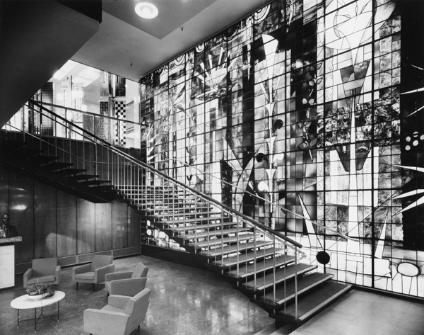 Picture of Sanderson House, Berners Street, London: close-up of the entrance stairs and stained glass window executed to John Piper's design by Patrick Reyntiens