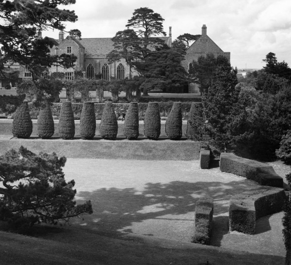 Picture of Dartington Hall, Dartington, Devon: the tiltyard with the restored medieval hall in the background