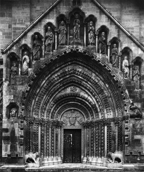 Picture of Benedictine Abbey Church of St George, Jak: the arcaded portal adorned with statues of the apostles and with a lion at both pedestal jambs