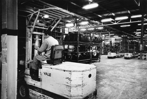 Picture of Forklift truck operator at work in a mechanized warehouse