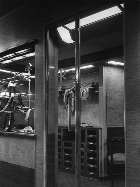Picture of Austin Reed on board the RMS Queen Mary: glass entrance doors with the firm's insigna