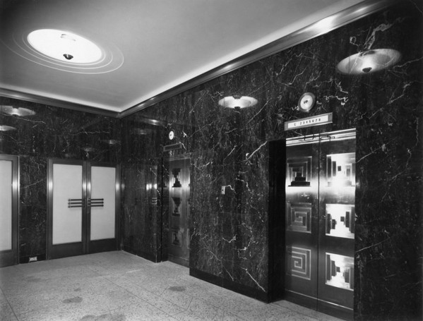 Picture of Berkeley Square House, Mayfair, London: the lifts in the entrance vestibule faced in Ashburton marble
