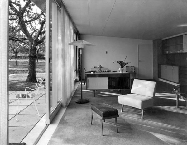 Picture of House, Otham, Kent: the living room and patio with chair by Ernest Race