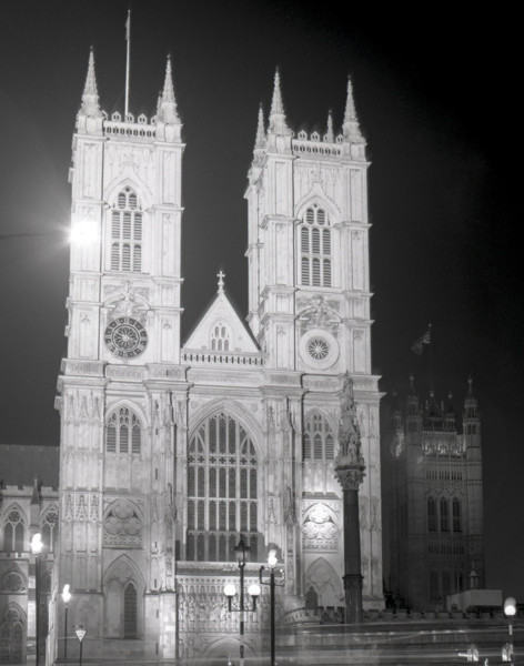 Picture of Westminster Abbey, London: the west front, floodlit at night with the Victoria Tower in the background